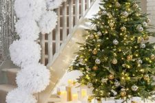 a christmas staircase decorated in a glam way