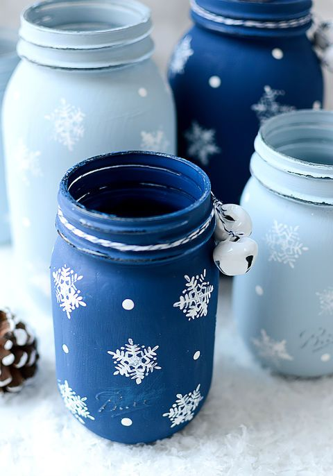 pastel and deep blue jars with painted snowflakes and bells can be used as vases for Christmas arrangements