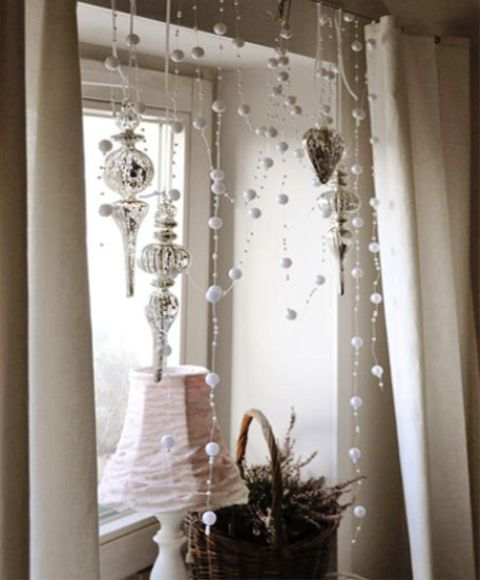pearls and beads plus silver ornaments hanging down complete the refined vintage space and make it feel beautiful and magical