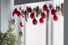 red, silver ornaments and dyed pinecones hanging on the shades will add a cool feel to the space and make it Christmassy