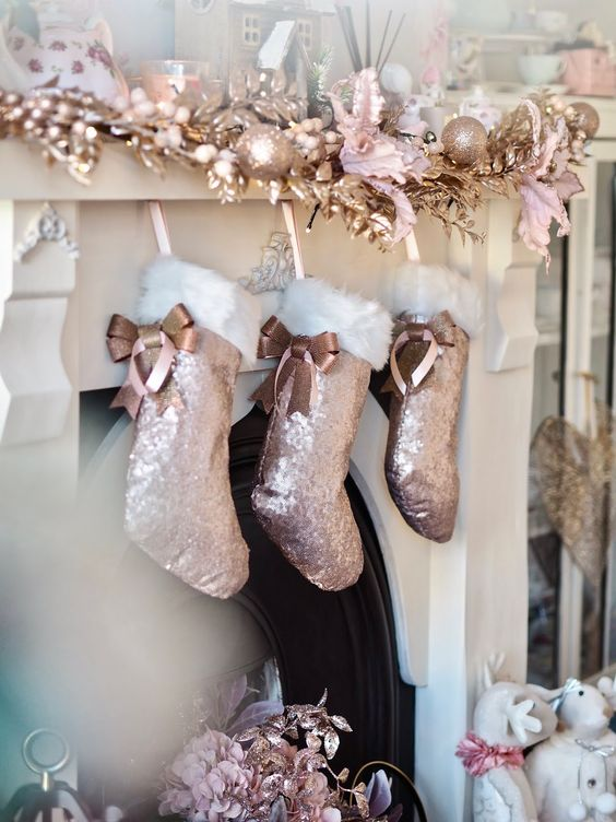 rose gold foliage, copper and pink ornaments, rose gold sequin stockings and candles for chic and glam Christmas decor
