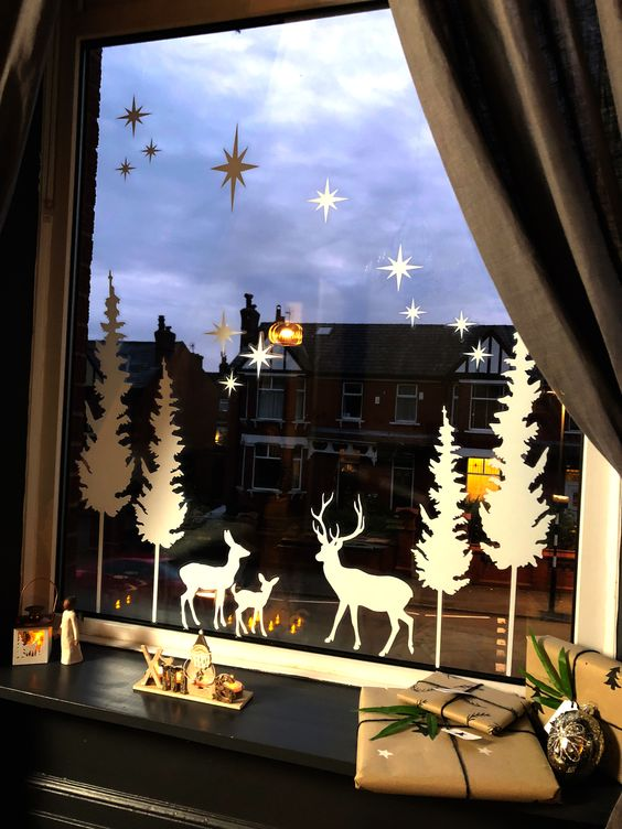 silhouettes attached to the window is a vintage and elegant way to decorate a window for Christmas and add a cozy feel to the space