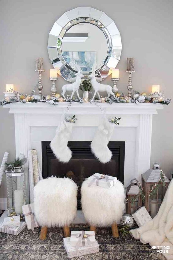 silver and gold ornaments, silver candleholders with candles, beads, fur stockings, oversized lanterns, silver ornaments and fir stools