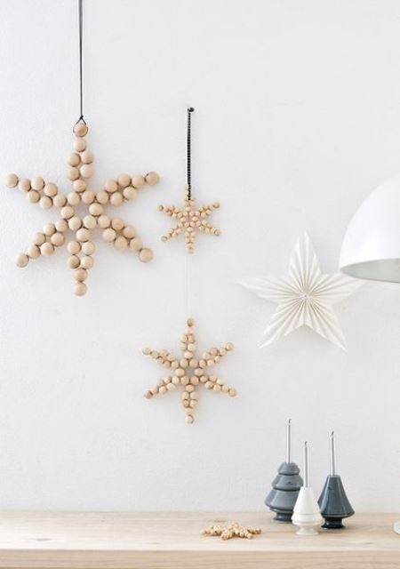simple and lovely Nordic Christmas decor with wooden bead stars and a paper folded one will bring peacefulness and coziness