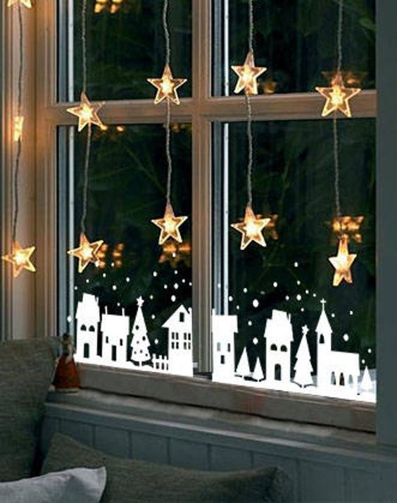 star lights paired with snowy house decals make the window look magical and kids will be happy to see such decor