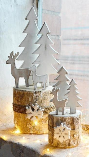 tree stumps with snowflakes attached with rope, with white trees and deer are lovely for creating a cozy winter scene