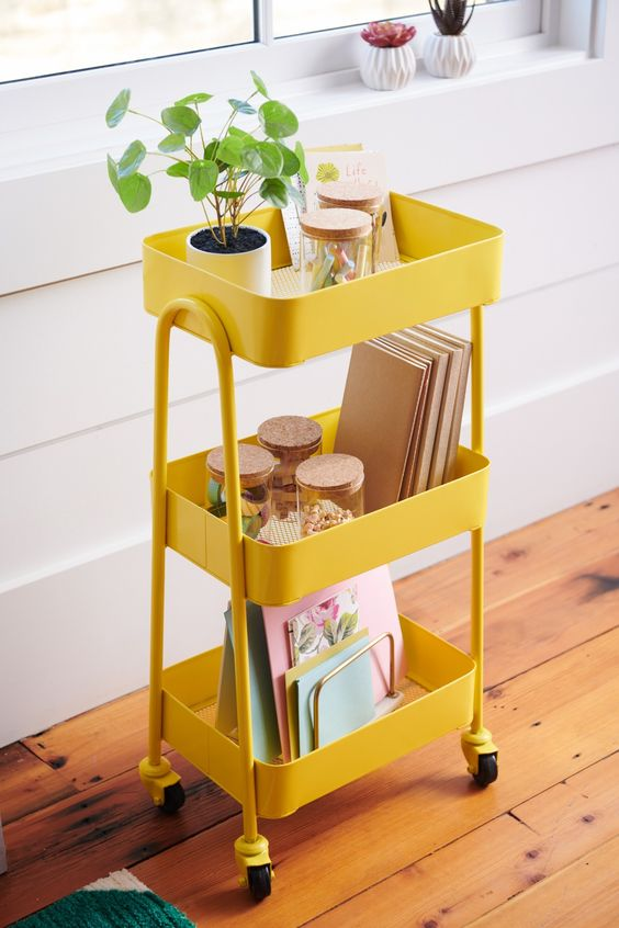 a yellow cart will easily make your kitchen, bathroom, craft room or any other space, and if you don't have a yellow one, spray paint what you have