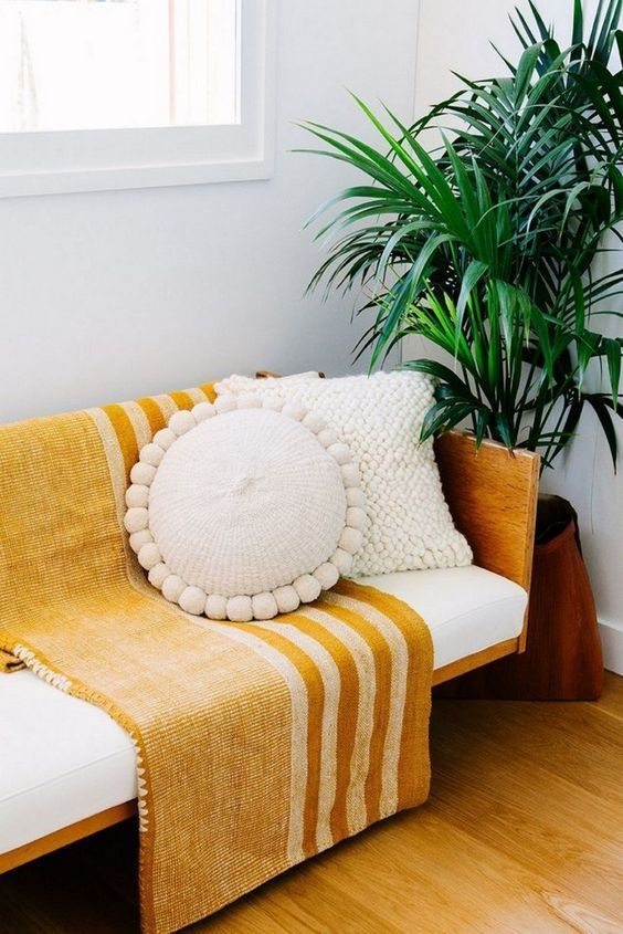 a mustard striped boho blanket will easily add a touch of sunshine to any space making it a bit more boho or modern