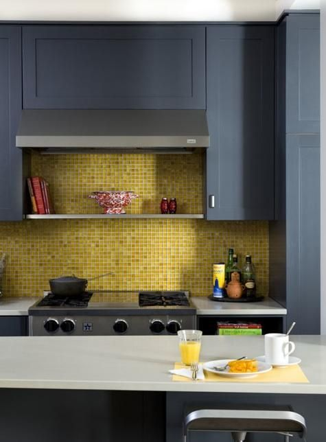 a bold kitchen with graphite grey cabinets, a bright yellow tile backsplash and white countertops is very cool