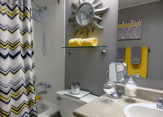 a chic grey and yellow bathroom with various shades of grey, a pritned curtain, bold yellow accessories looks cool