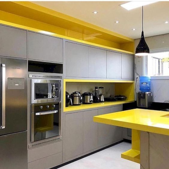 a minimalist grey kitchen with lemon shade accents and niches plus black touches here and there looks wow