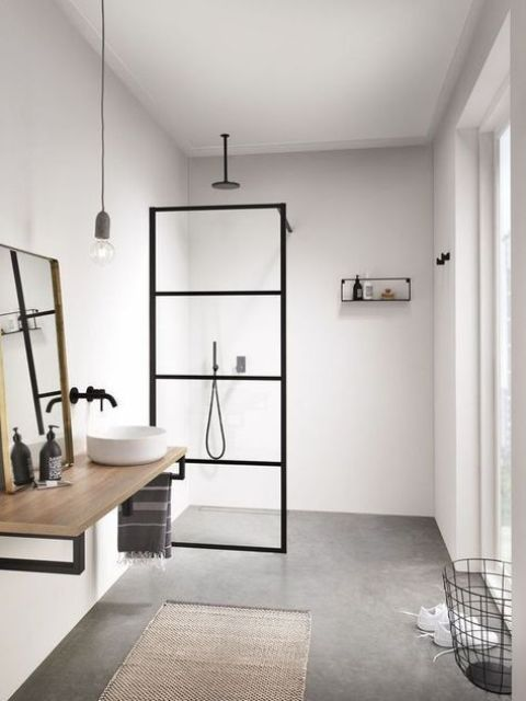 a neutral Scandi bathroom with black touches for drama, with wood and a jute rug plus a wire basket