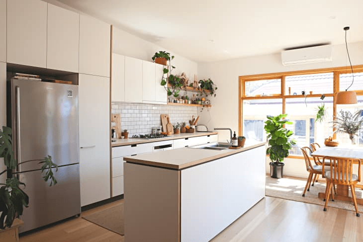 a stylish contemporary white one wlal kitchen with a kitchen island, wooden countertops, potted plants and a white tile backsplash