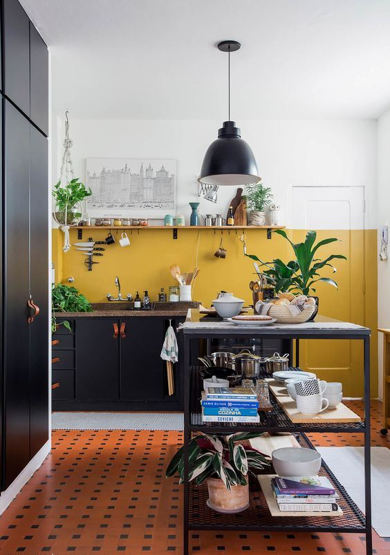 a mustard color block wall and potted greenery and plants for a fresh and cool spring touch in the kitchen