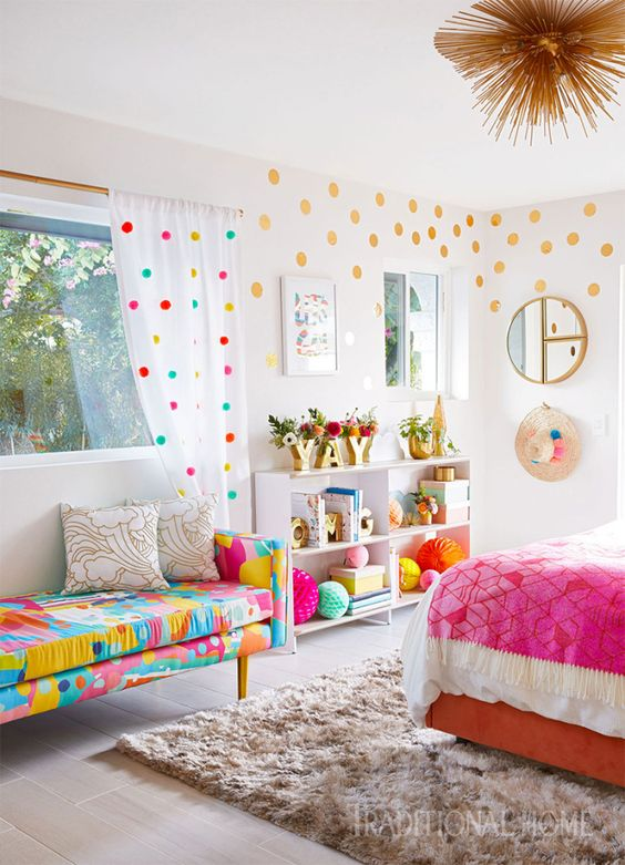 a colorful daybed and matching polka dot curtains give this bedroom and cheerful and bold look