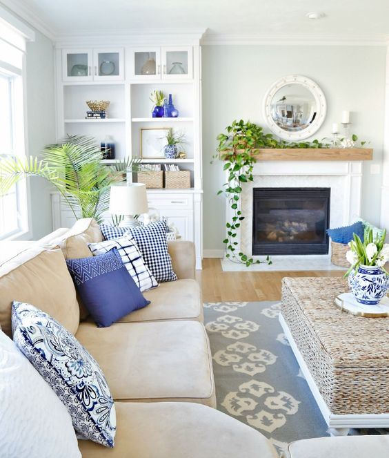 a blue and white spring living room with printed accessories, potted greenery feels veyr fresh and spring-like