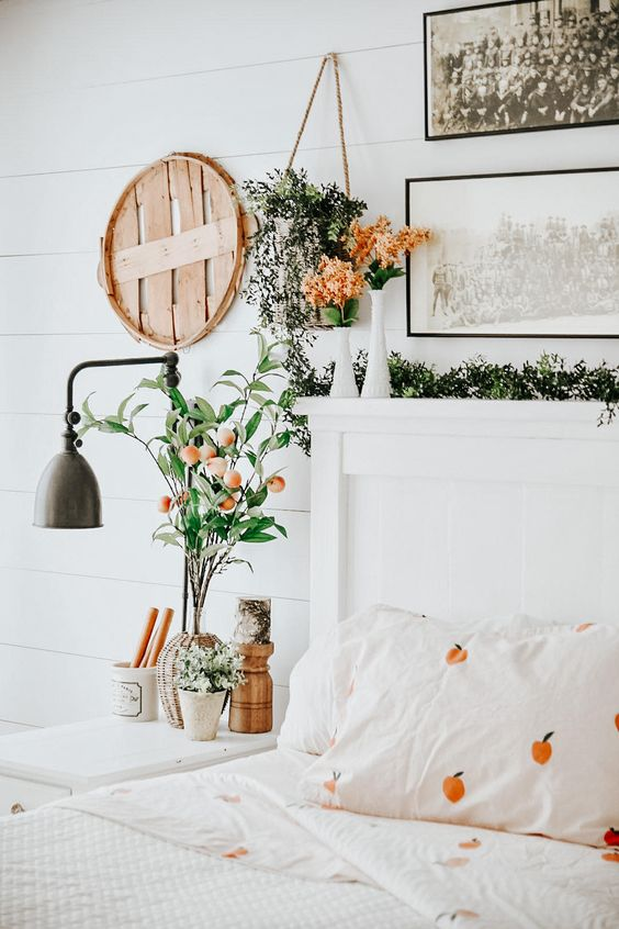 fake and fresh blooms, greenery and pretty fruit print bedding will easily give a slight spring touch to the space