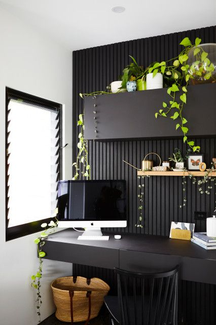 18 a contemporary black home office refreshed with potted greenery everywhere, which brings a fresh spring feel to the space
