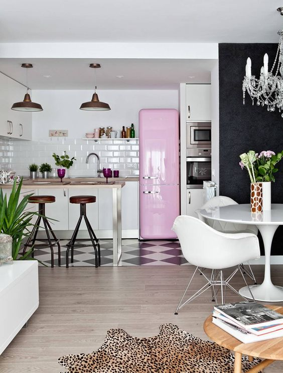 a pink fridge will instantly raise your kitchen design to a new level, even if it's monochromatic and cool