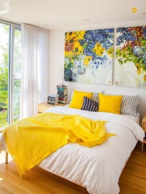 bold yellow pillow cases and a blanket will add a touch of color to the space and make it shiny and bright