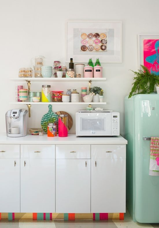 bright tableware and boxes, bold mugs, a bold artwork and potted greenery for a fun and bold kitchen with a spring feel