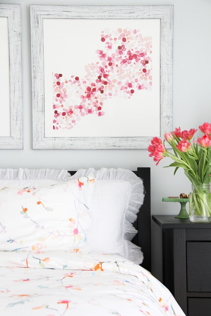 bright floral bedding and bold artworks and flowers will make your bedroom welcoming and spring-ready