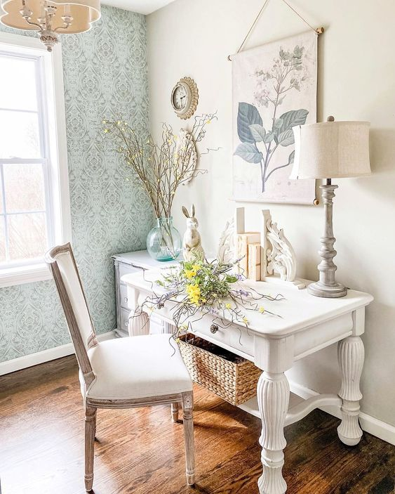 a spring home office done with blue printed wallpaper, branches, blooms, a botanical poster is a chic space