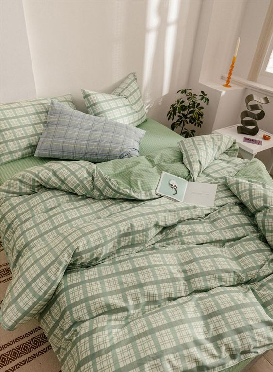 pretty green bedding with a traditional plaid print looks fresh, calming and soothing and very spring-like