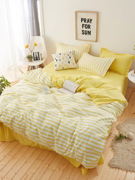 sunny and fun yellow bedding with striped and cactus print pieces is a lovely idea to spruce up your room for spring