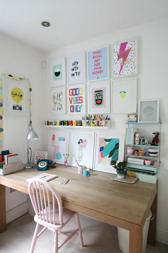 a gallery wall with bright artworks and colorful touches is a lovely and easy idea to decorate your home office for spring