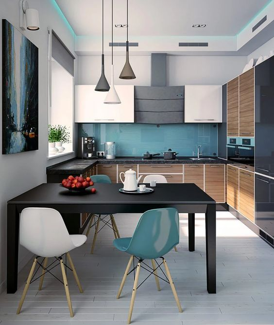 a contemporary kitchen with white, black and stained wood cabinets, a blue glass backsplash, a cool dining zone with blue and white chairs