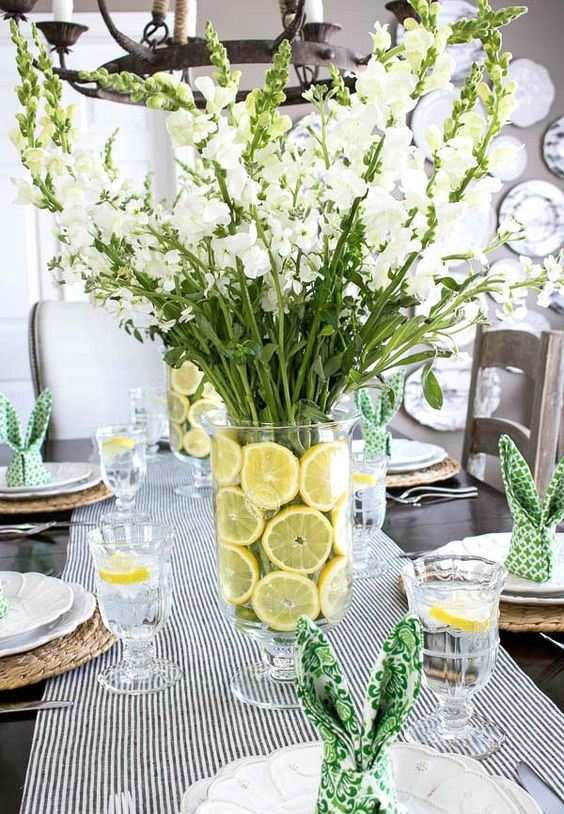 a colorful spring centerpiece with citrus slices