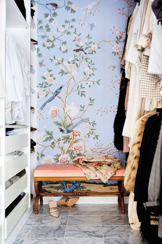a girl's closet accented with lovely blue floral wallpaper to create a light feeling and give an airy touch to the space