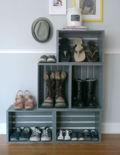 a graphite grey storage unit made of crates is an ideal piece for an entryway and is easy to compose