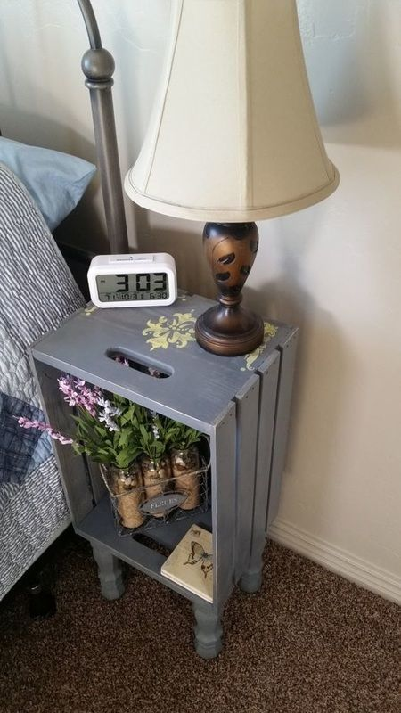 a grey crate nightstand on vintage legs, with some blooms in jars and a vintage table lamp is a lovely idea to rock