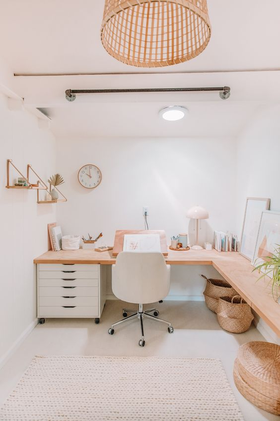 a light pretty boho home office with a corner desk, a white storage unit, a wicker pendant lamp and hanging shelves plus baskets