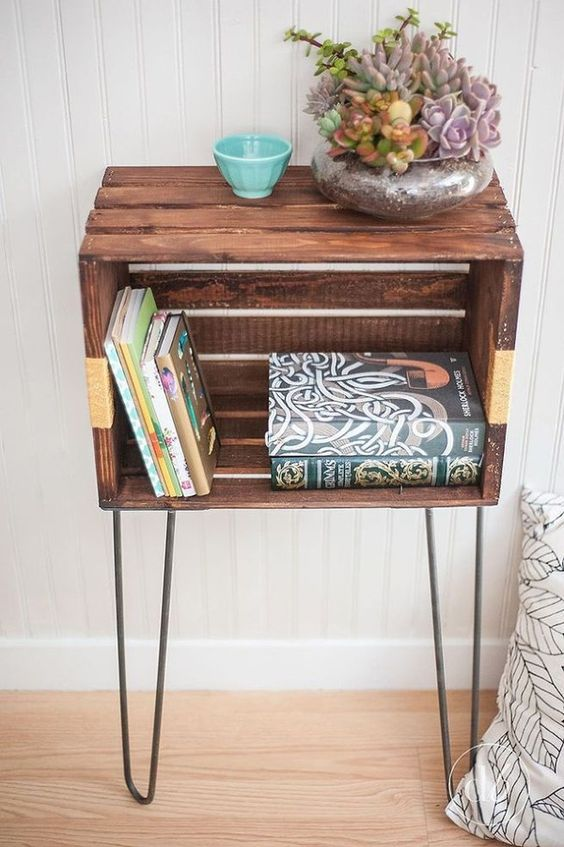 a rustic crate nightstand with hairpin legs, with books and a potted succulents is a very cute and chic idea