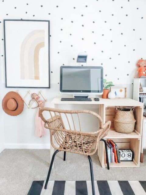 a small and cool desk with crates for open storage and a small tabletop plus a wicker chair compose a cool working setup