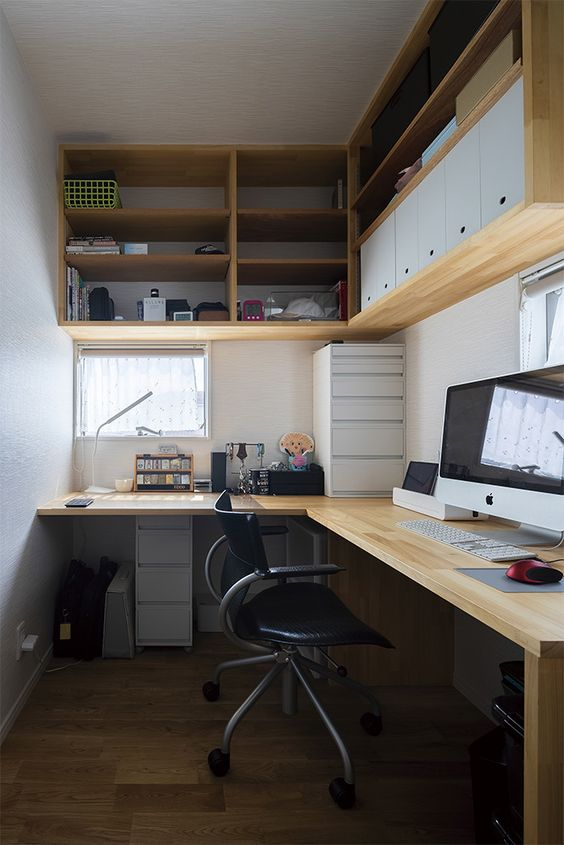 a small contemporary home office with an open and a closed storage unit on the wall, a corner shelf, a black chair and a small window