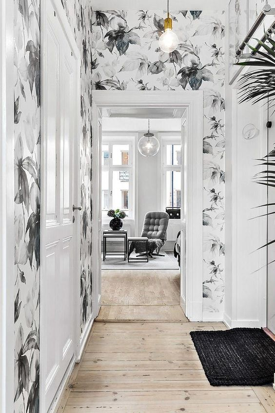 a small hallway accented with pretty light botanical wallpaper looks more interesting and catches an eye with the print