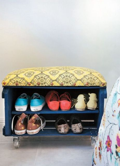 a small shoe rack of a crate painted blue, placed on casters and with an upholstered seat is a lovely idea for an entryway