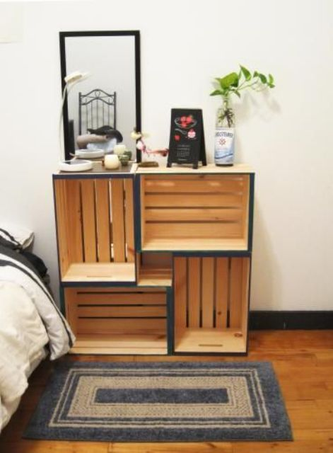 a stylish nightstand with storage space composed of crates with a colorful edge is a cool idea for a farmhouse bedroom