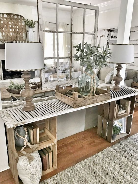 a vintage farmhouse console table with some crates and a vintage shutter over them is a creative idea with plenty of storage