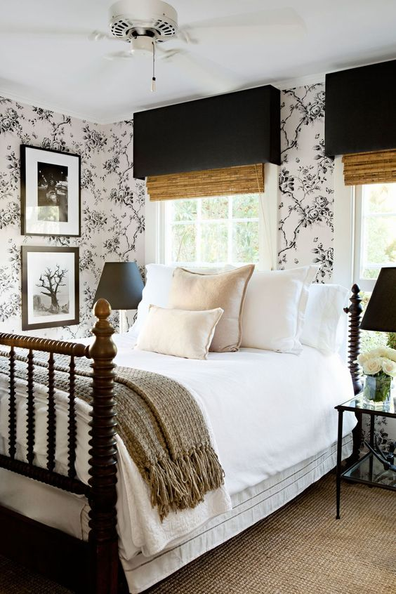 an elegant and stylish modern bedroom in a monochromatic color scheme with black and white floral wallpaper and shades, black lamps