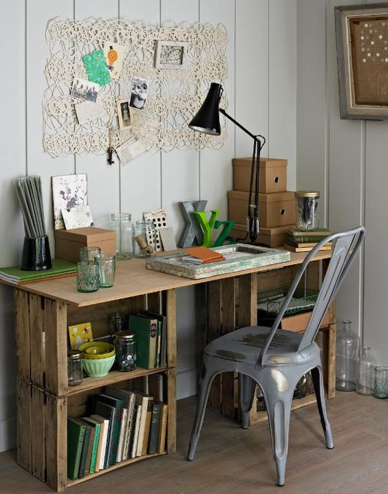 an industrial desk of crates and a wooden tabletop is a lovely and cool idea for a home office, it gives you a lot of storage space