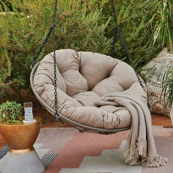 an outdoor swining papasan chair with a cushion and a blanket, a side table will be a lovely idea for your terrace