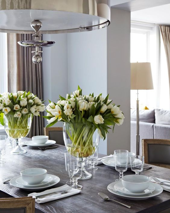 classic white tulip centerpiece in large glass-shaped vases are timeless and elegant and will do in many times