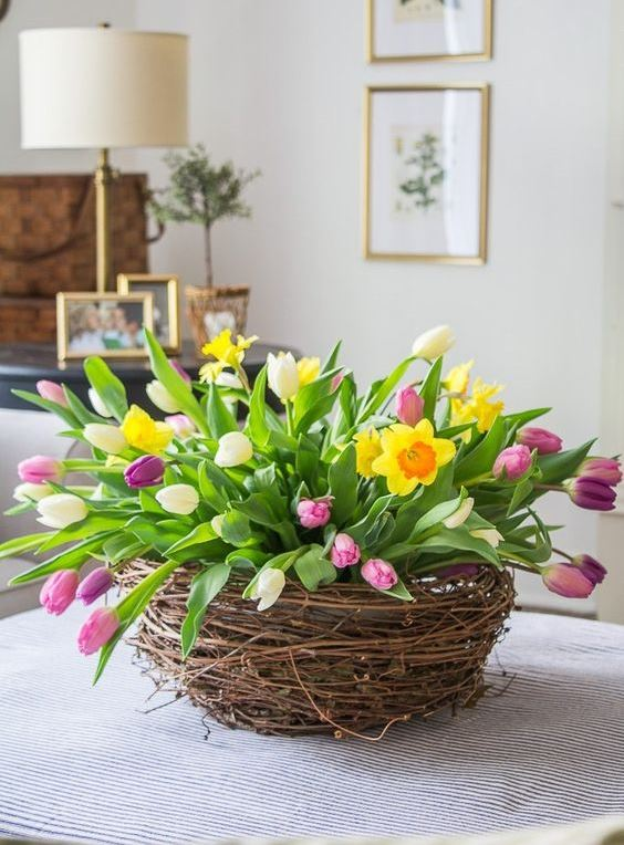 colorful tulips in a nest is a bold and cool floral arrangement to rock as a centerpiece or decoration in spring
