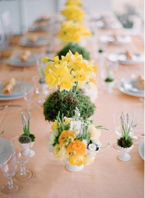 yellow floral arrangements on moss are pretty and fun spring centerpieces that you may rock