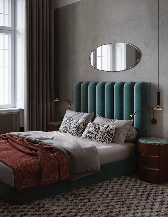 a green upholstered bed with a channel tufted headboard is a stylish art deco piece that will make your bedroom cooler